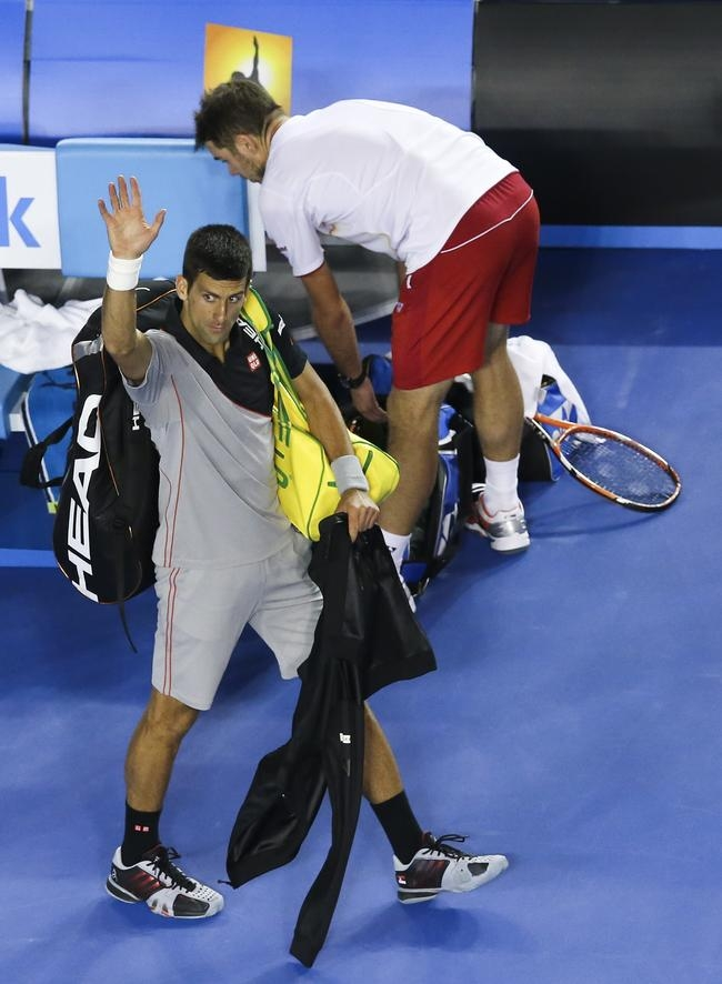 Novak Djokovic of Serbia waves to the crowd after losing his quarterfinal match against Stanislas Wawrinka