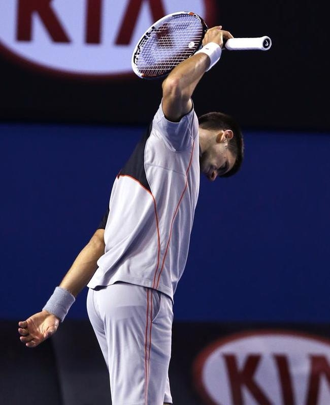 Novak Djokovic of Serbia reacts after losing a point during his quarterfinal against Stanislas Wawrinka