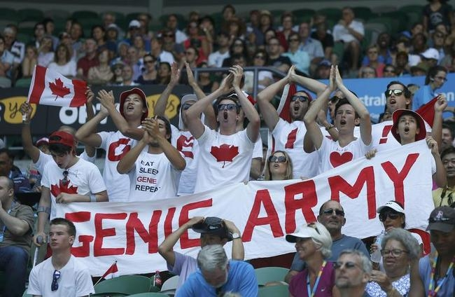 Supporters of Eugenie Bouchard of Canada cheer during her women