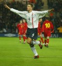 Steven Gerrard of England celebrates scoring a goal