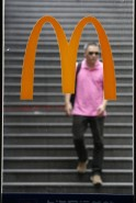 A man is seen walking down a flight of stairs through window of a McDonald store in Shanghai