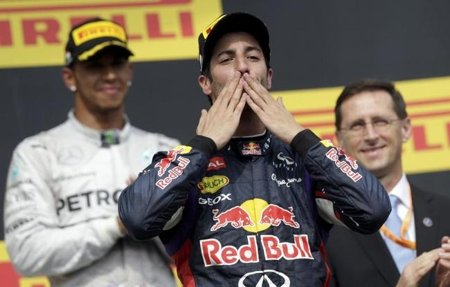 Winner Red Bull Formula One driver Ricciardo of Australia celebrates in front of third placed Mercedes Formula One driver Hamilton of Britain after the Hungarian F1 Grand Prix at the Hungaroring circuit, near Budapest