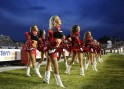 Calgary Stampeders cheerleaders dance on the sidelines in their game against the Hamilton Tiger-Cats during the second half of their CFL football game in Calgary