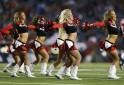Calgary Stampeders cheerleaders dance during a break in their CFL football game against the Hamilton Tiger-Cats in Calgary