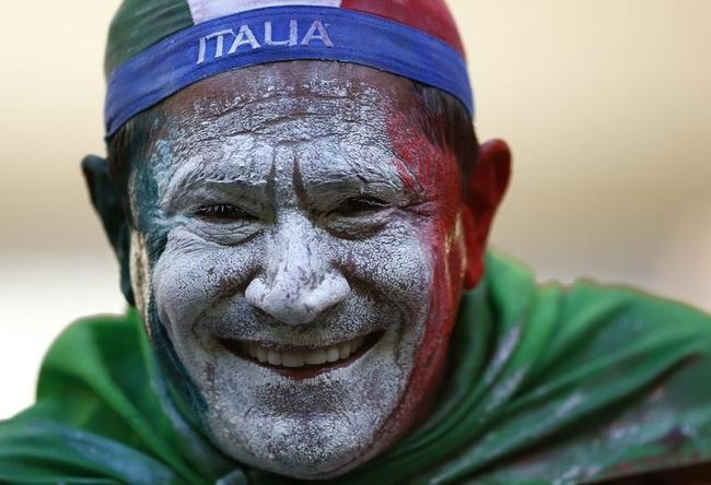 Italy fan poses before World Cup soccer match between England and Italy at the Amazonia arena in Manaus
