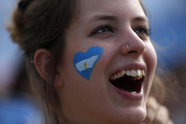 An Argentinian soccer fan reacts while watching the screening of a 2014 World Cup soccer match in Rio de Janeiro