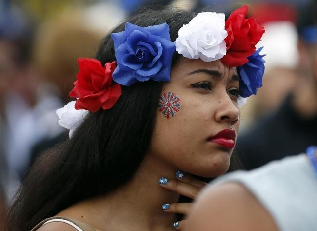 A USA fan watches the 2014 World Cup Group G soccer match between Germany and the U.S. at a viewing party in Hermosa Beach