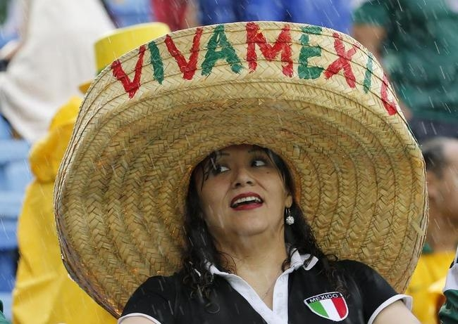 A fan of Mexico is seen ahead of the team