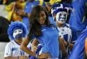 A fan of Honduras poses before their 2014 World Cup Group E soccer match against Ecuador