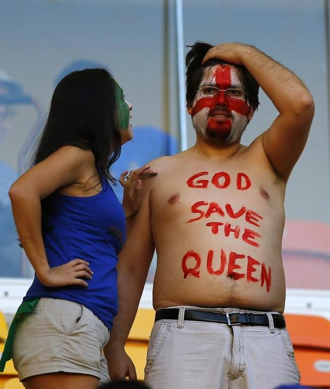 Fans wait before the 2014 World Cup Group D soccer match between England and Italy at the Amazonia arena in Manaus