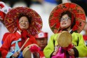Fans of South Korea wait for the start of their 2014 World Cup Group H soccer match against Belgium at the Corinthians arena in Sao Paulo