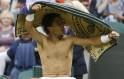 Rafael Nadal of Spain dries himself with a towel during a break in his men
