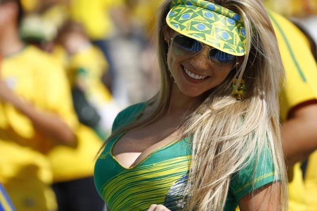 A Brazilian fan attends the opening ceremony of the 2014 World Cup at the Corinthians arena in Sao Paulo