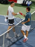 Roger Federer of Switzerland shakes hands with Tomas Berdych of Czech Republic after their men