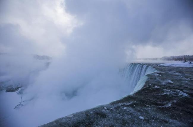 Mist rises over the Horseshoe Falls during sub freezing temperatures in Niagara Falls