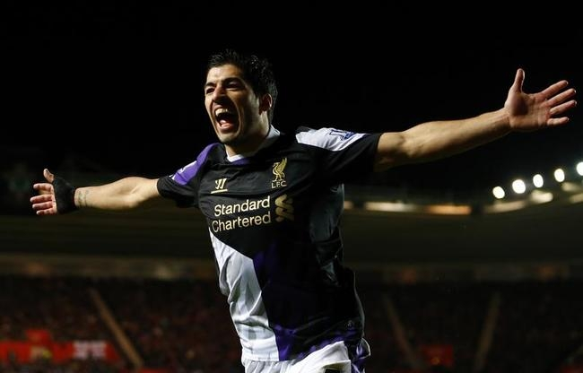Suarez of Liverpool celebrates after passing to Stirling who scored against Southampton during their English Premier League soccer match in Southampton