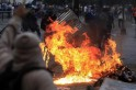 Anti-government protesters erect a fiery barricade during clashes with police at Altamira square in Caracas