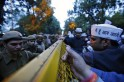 Supporters of AAP stand behind a barricade installed by Indian policemen during a protest outside the headquarters of BJP in New Delhi