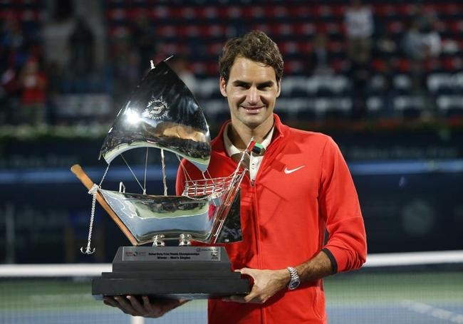 Roger Federer of Switzerland holds trophy after defeating Tomas Berdych of Czech Republic in men