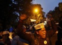 Supporters of AAP shout slogans during a protest outside the headquarters of BJP in New Delhi