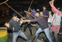 Supporters of AAP and BJP clash during a protest outside the office of BJP in Lucknow