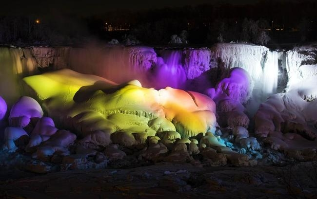 A partially frozen Niagara Falls is seen on the American side lit by lights during sub freezing temperatures in Niagara Falls