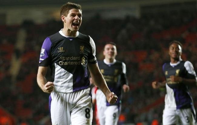 Steven Gerrard of Liverpool celebrates scoring a penalty against Southampton during their English Premier League soccer match at St Mary