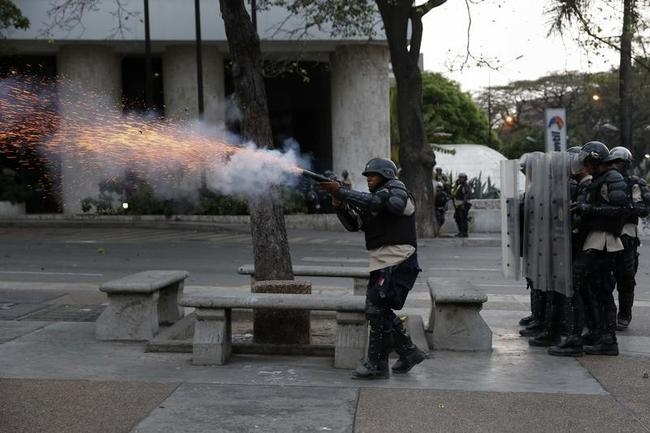 Police fire teargas at anti-government protesters at Altamira square in Caracas