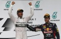Mercedes Formula One driver Hamilton of Britain celebrates on the podium as he stands beside third-placed Red Bull Formula One driver Vettel of Germany after the Malaysian F1 Grand Prix at Sepang International Circuit outside Kuala Lumpur