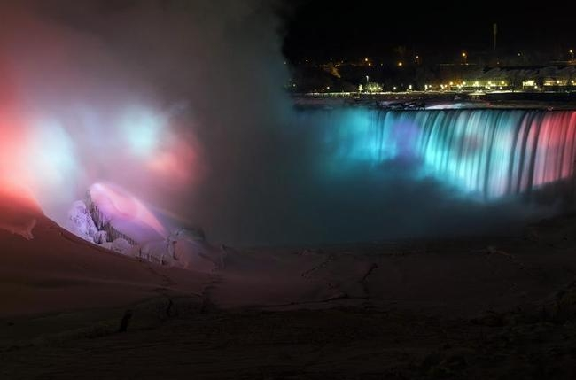 A partially frozen base of Horseshoe Falls is seen on lit by lights during sub freezing temperatures in Niagara Falls,