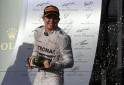 Winner Mercedes Formula One driver Rosberg of Germany sprays champagne after the Australian F1 Grand Prix in Melbourne
