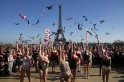 Women toss their bras during the 5th Pink Bra Spring and Bra Toss and help Push Up the Fight Against Breast Cancer at the Trocadero Square near the Eiffel Tower in Paris
