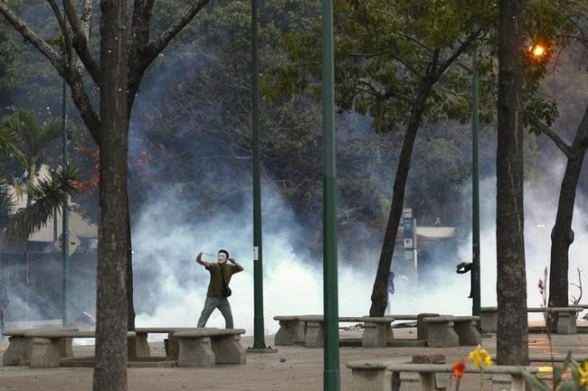 Anti-government protesters clash with riot police in Caracas