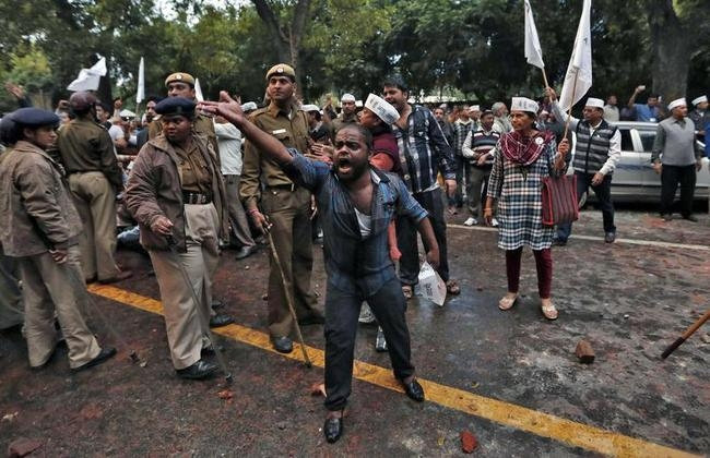 A supporter of AAP shouts slogans during a protest outside the headquarters of BJP in New Delhi