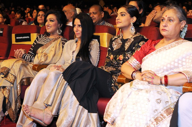 Tollywood actress Sudipta Chakroborty (L) with singer Usha Utthup (R) during 1st Vivel Filmfare Awards 2013 (East) at Science City auditorium in Kolkata