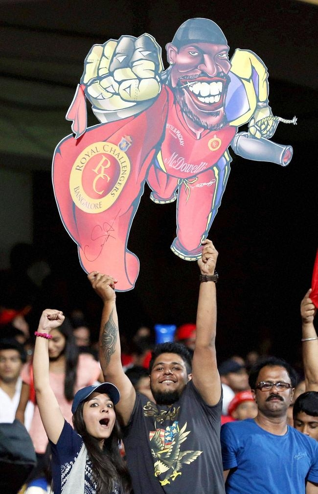 Fan with a Cartoon cut out of Chris Gayle
